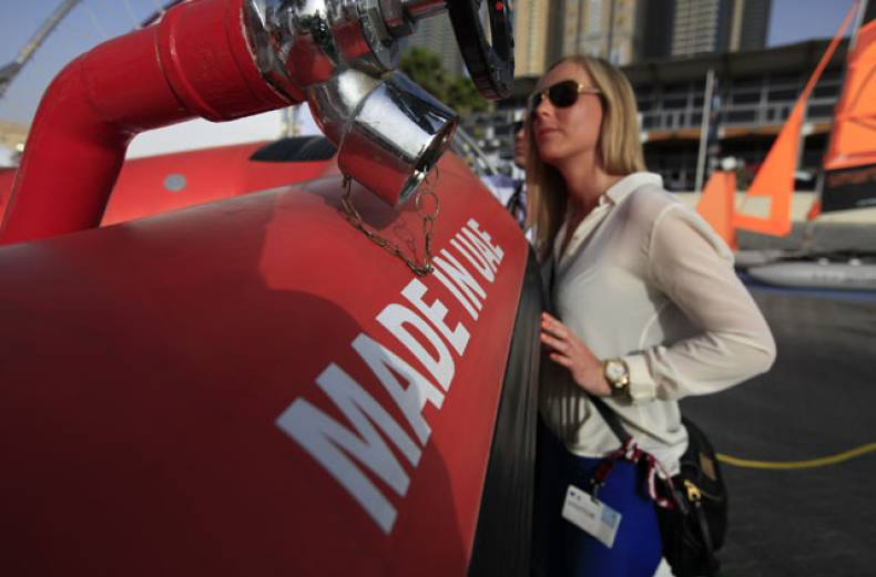 a-visitor-checks-out-a-fire-boat-displayed-at-the-emirates-inflatables-stand